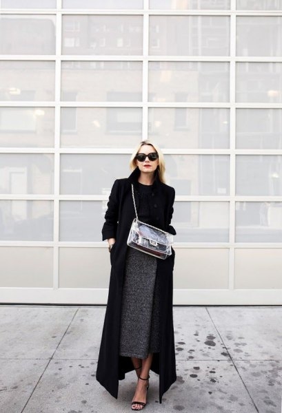 black maxi length coat with sweater and midi heather grey skirt