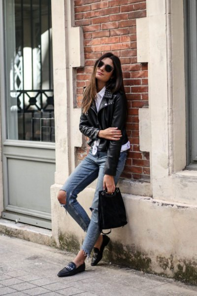 black moto jacket with grey heavily ripped jeans and leather loafers