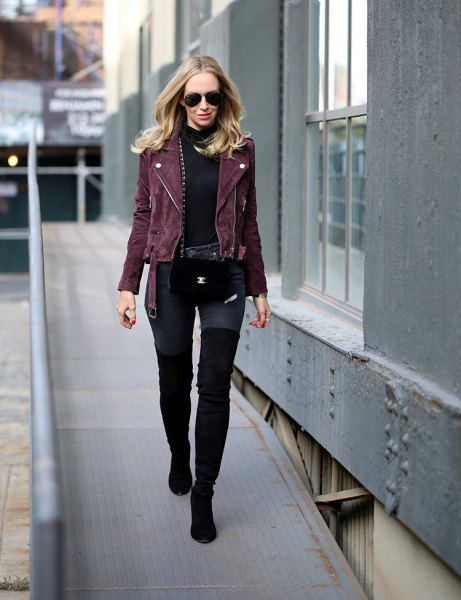 black moto jacket with mock neck sweater and thigh high boots