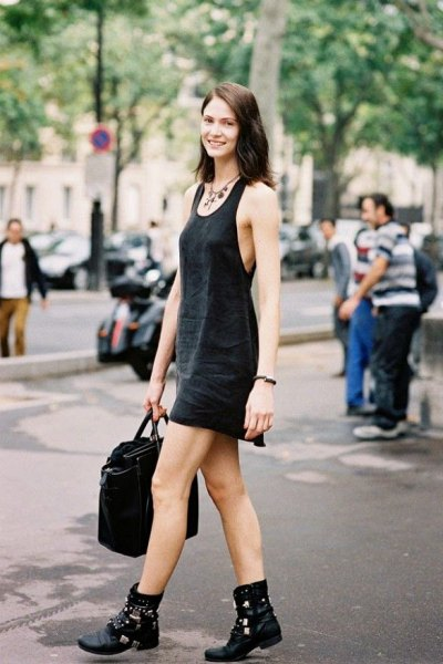 black scoop neck mini tank shift dress with biker leather boots