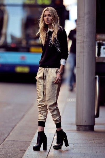 black sweater with white collar shirt and metallic jogger pants
