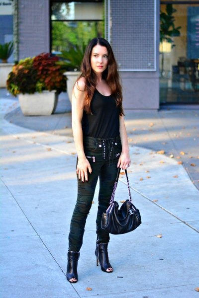 black tank top with moto lace up pants