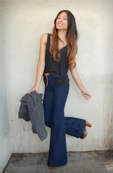 black tank top with navy blue high waisted flared jeans