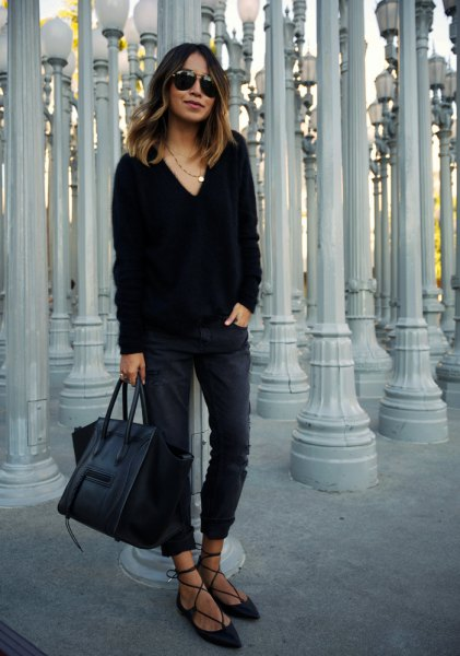 black v neck chunky sweater with slim fit jeans and strappy velvet flats