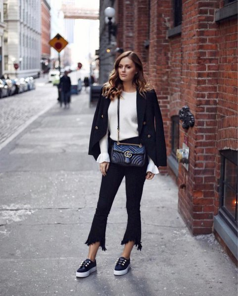 black wool blazer with white knit sweater and flared cropped jeans