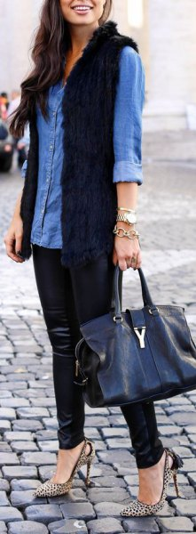 blue chambray button up shirt with black longline fur vest