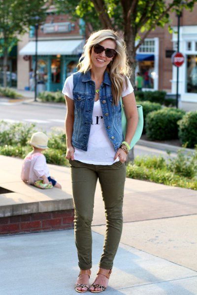 blue denim vest with green slim fit jeans and flip flops