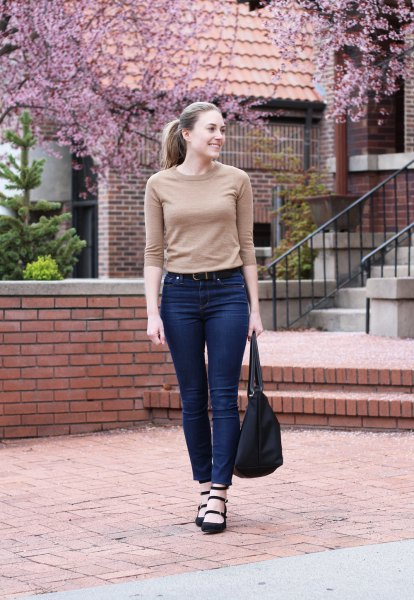blush pink half sleeve cashmere fitted sweater with blue high waisted jeans