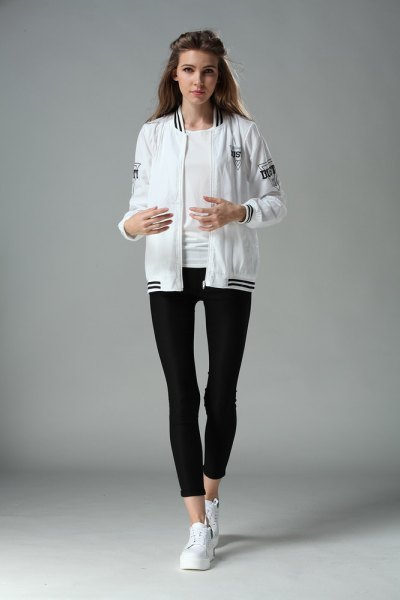 bomber jacket with black cropped leggings and white sneakers