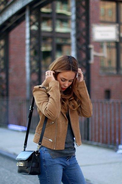 brown moto jacket with blue slim fit jeans