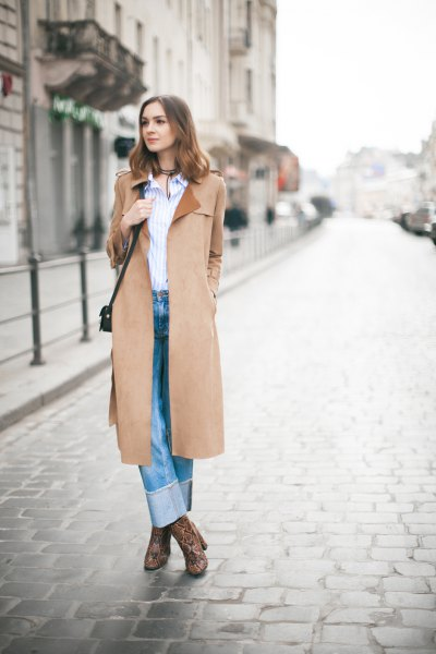 camel coat with blue and white vertical striped shirt and cuffed jeans