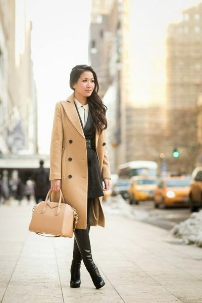 camel midi length double breasted wool coat with leather thigh high boots