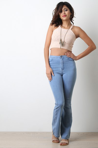cropped form fitting pale pink vest top with light blue high rise jeans