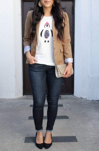 fitted jacket with white print tee and dark blue skinny jeans