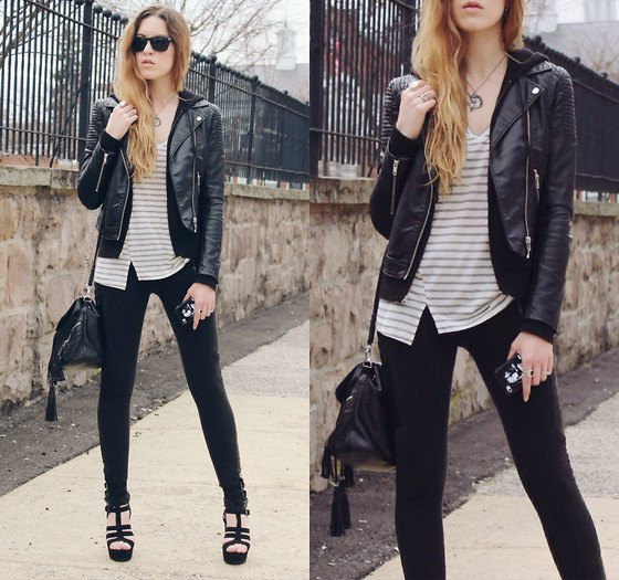 fitted moto jacket with grey and white striped v neck top and skinny jeans