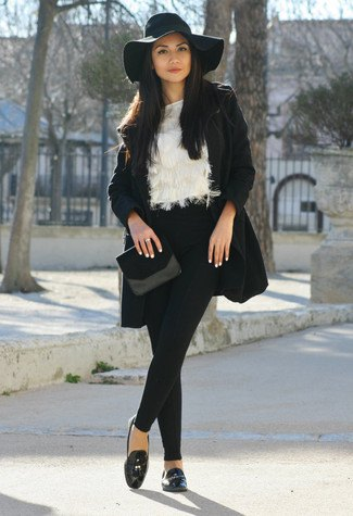 floppy black hat with wool coat and faux fur blouse