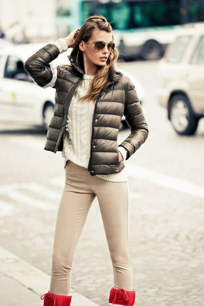 green bubble jacket with white cable knit sweater and blush pink jeans