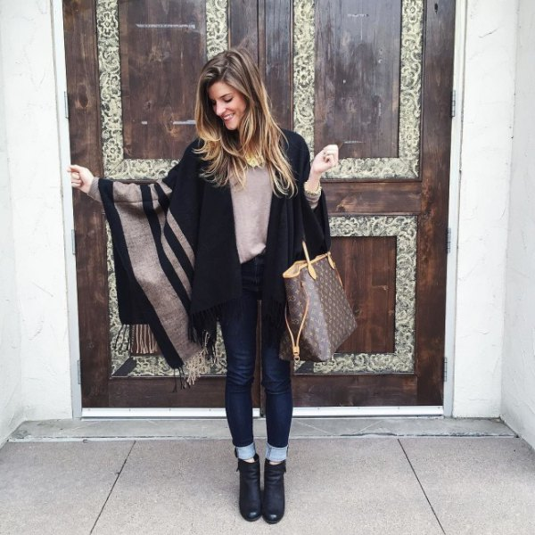 grey and black striped cape with dark blue cuffed skinny jeans
