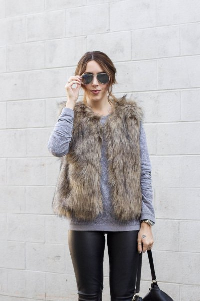 grey crew neck sweater with brown faux fur vest