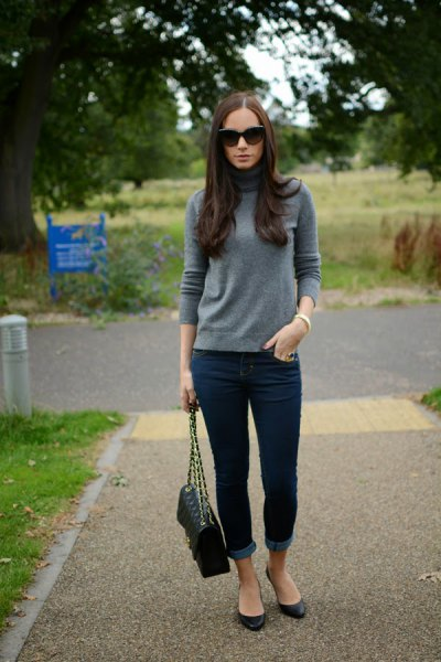 grey mock neck cashmere sweater with dark blue cuffed skinny jeans