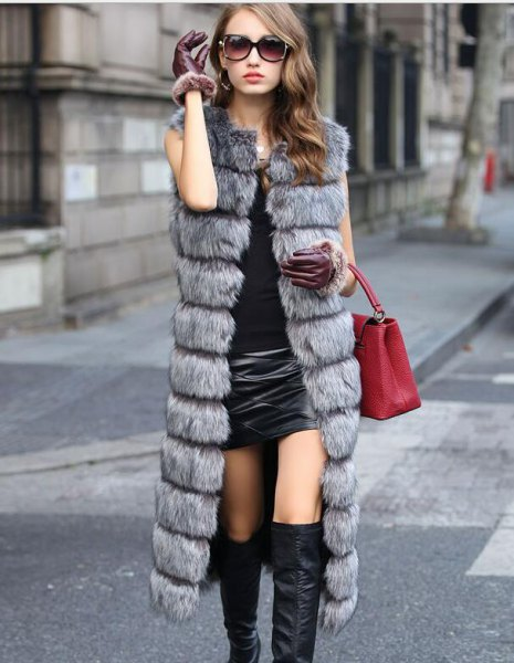 grey quilted faux fur long vest with black mini leather skirt