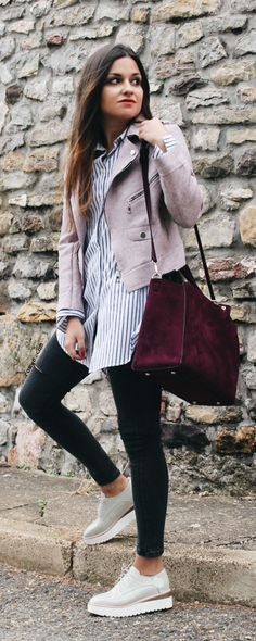 grey short suede jacket with blue and white striped tunic shirt