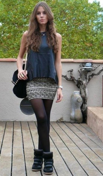 grey sleeveless top with tribal printed mini skirt and stockings
