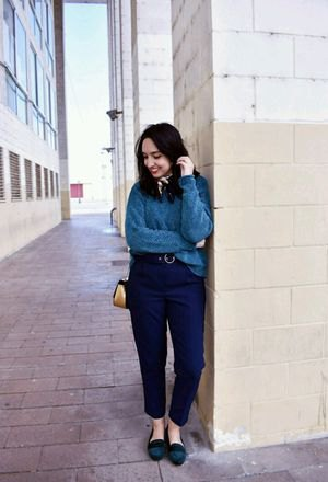 grey sweater with navy blue ankle pants