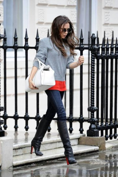 grey sweater with orange t shirt and blue skinny jeans