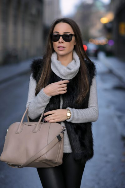 grey turtleneck sweater with black faux fur vest and leather leggings