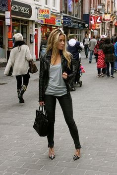 leather jacket with grey scoop neck top and skinny jeans