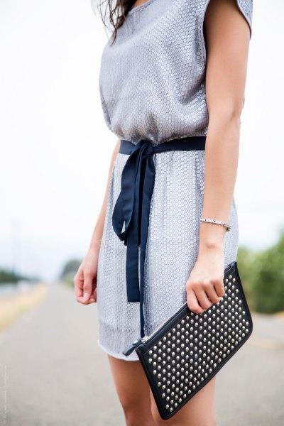 light blue belted sleeveless summer tunic dress with black clutch bag
