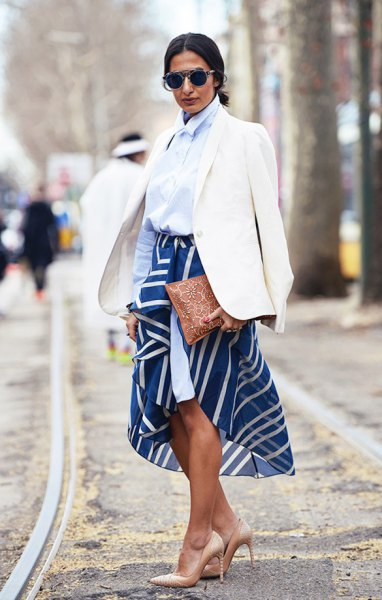 light blue button up shirt and navy printed midi skirt