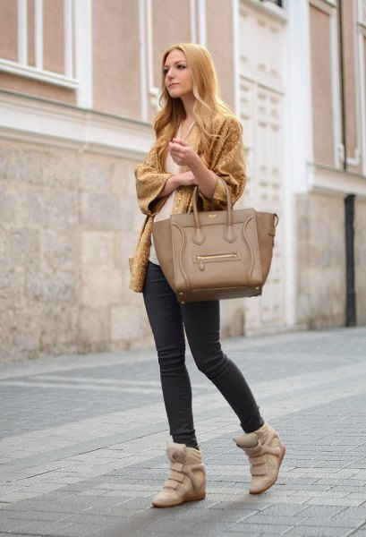 lime green wide sleeve knit cardigan with skinny jeans and blush wedge sneakers