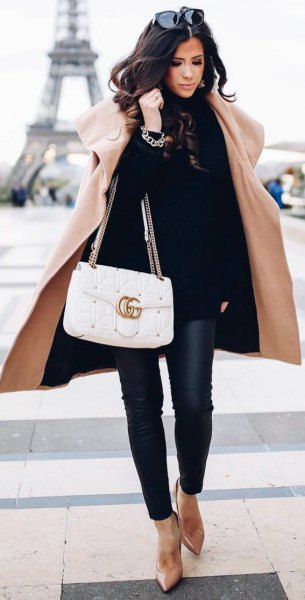 long coat with black turtleneck sweater and leather pants
