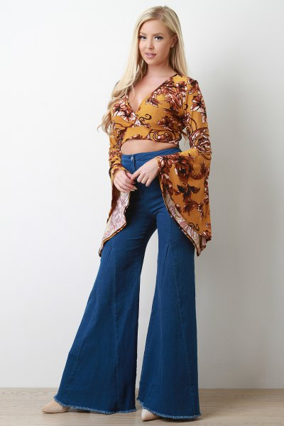 mustard yellow printed bell sleeve cropped blouse with flared jeans