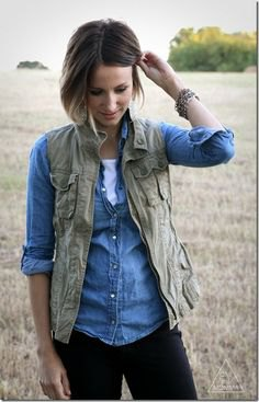 olive green vest with chambray light blue shirt and dark jeans