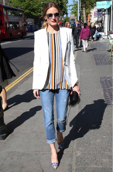 orange and black vertical striped blouse and cuffed jeans