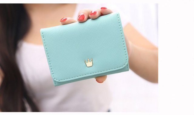 pale blue little cute purse with white t shirt and blue denim mini skirt