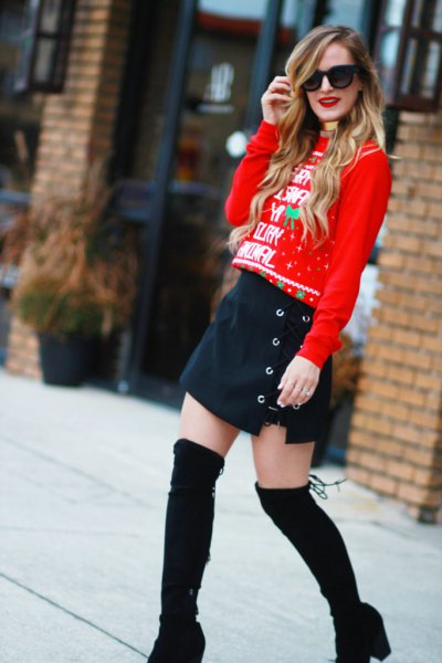 red christmas sweater with navy blue button front mini skirt