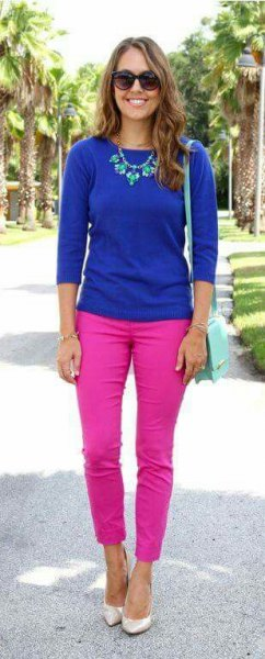 royal blue three quarter sleeve sweater with hot pink slim fit jeans