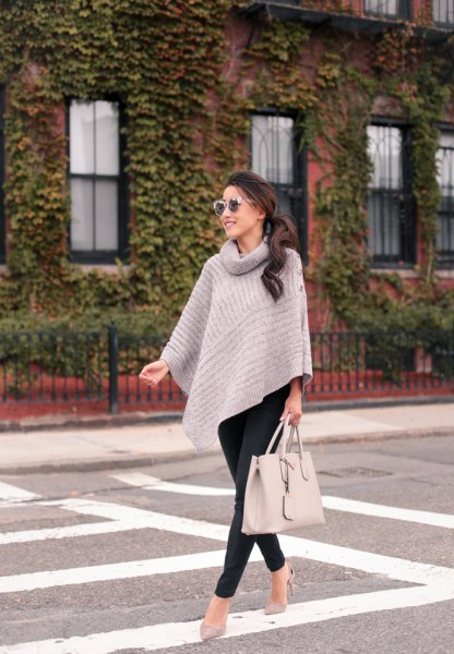 turtleneck grey cape sweater with black slim fit pants