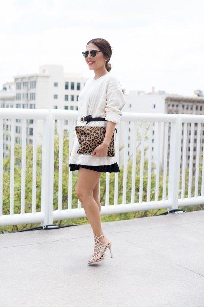 white belted oversized sweater with mini skater skirt