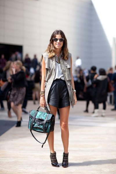 white blouse with long vest and black leather flowy shorts