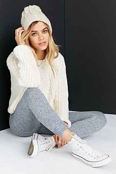 white cable knit sweater with grey sweater knit leggings