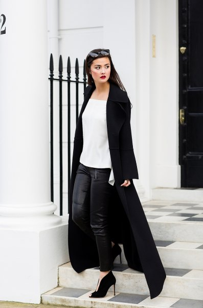 white chiffon blouse with black leather leggings and maxi coat