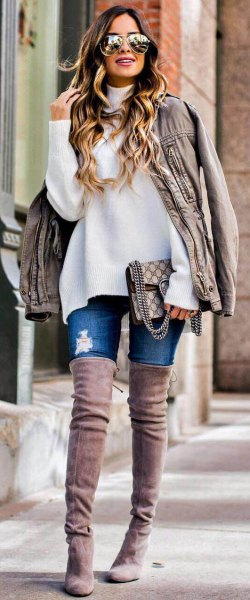 white chunky sweater with light grey oversized leather jacket and thigh high suede fall boots