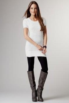 white form fitting short sleeve sweater dress with leggings