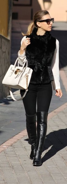 white long sleeve tee with black button up fur vest and leather boots
