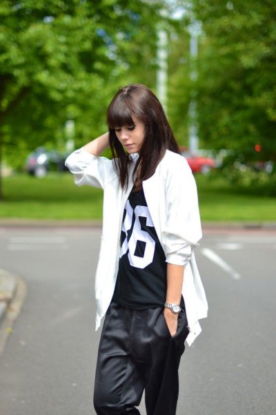 white oversized jacket with black print tee and baggy pants